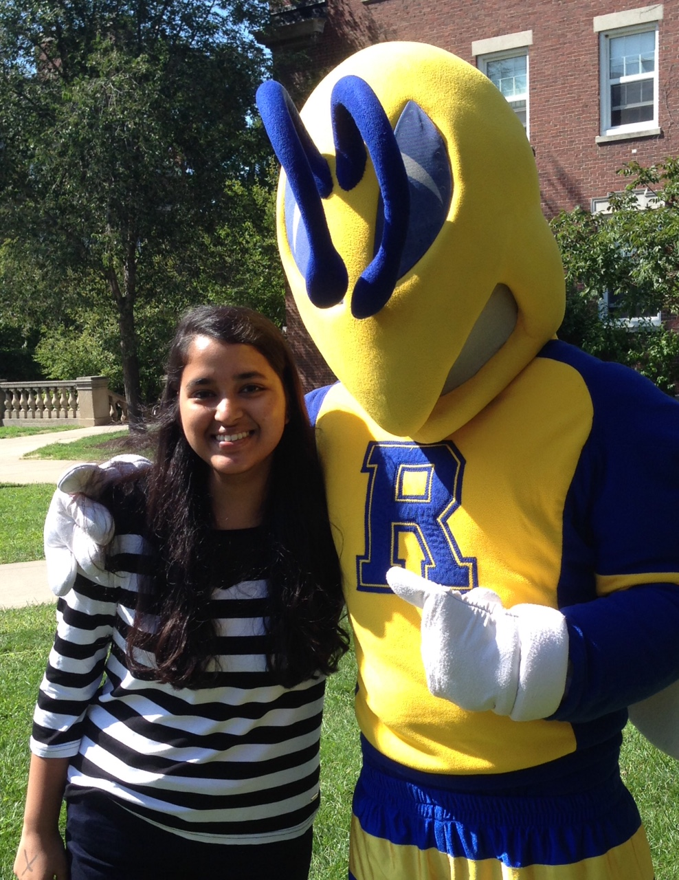 Me, posing with Rocky, the school mascot.
