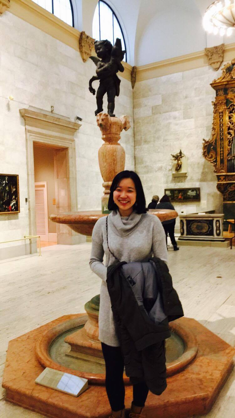 Me in front of an angelic fountain statue in Memorial Art Gallery