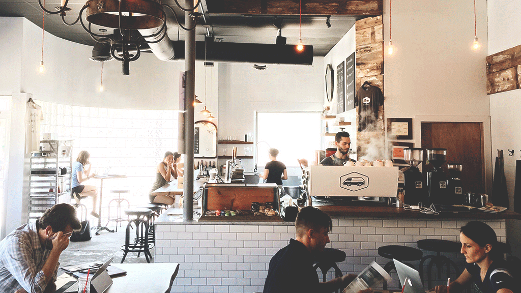 Bright and airy coffee shop with people working and drinking coffee