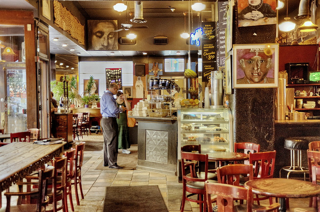 Eclectic coffee shop with art all over the walls and a small bakery