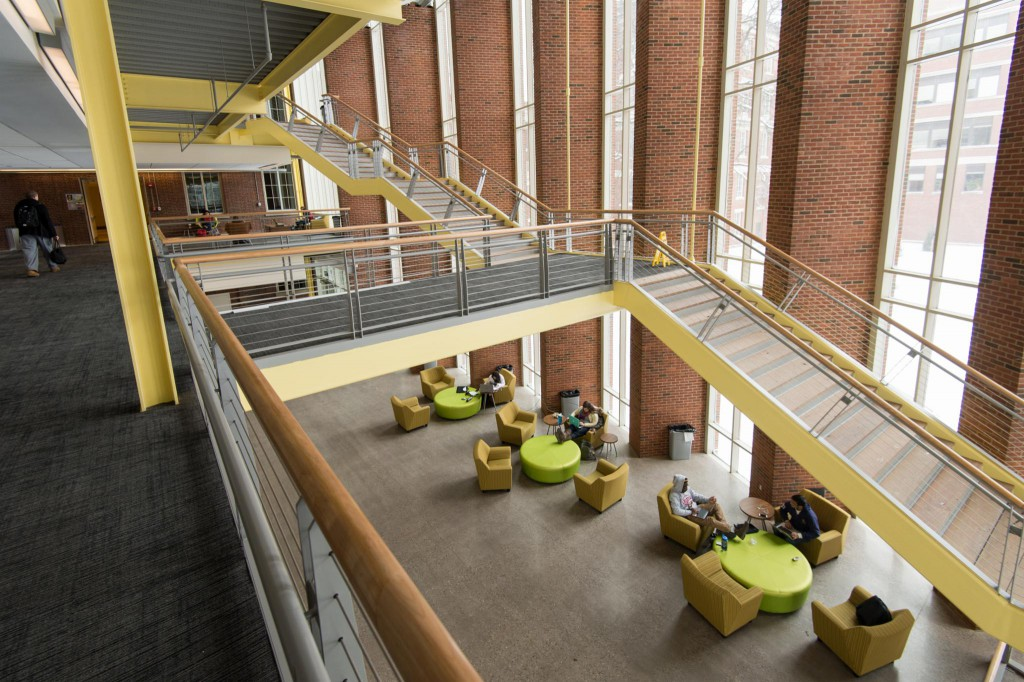 Rettner Hall, a futuristic space with open staircases and brick and yellow metal accents