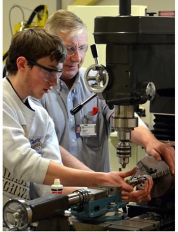 Jim Alkins helps a student