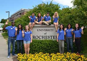 Students pose in front of University of Rochester sign