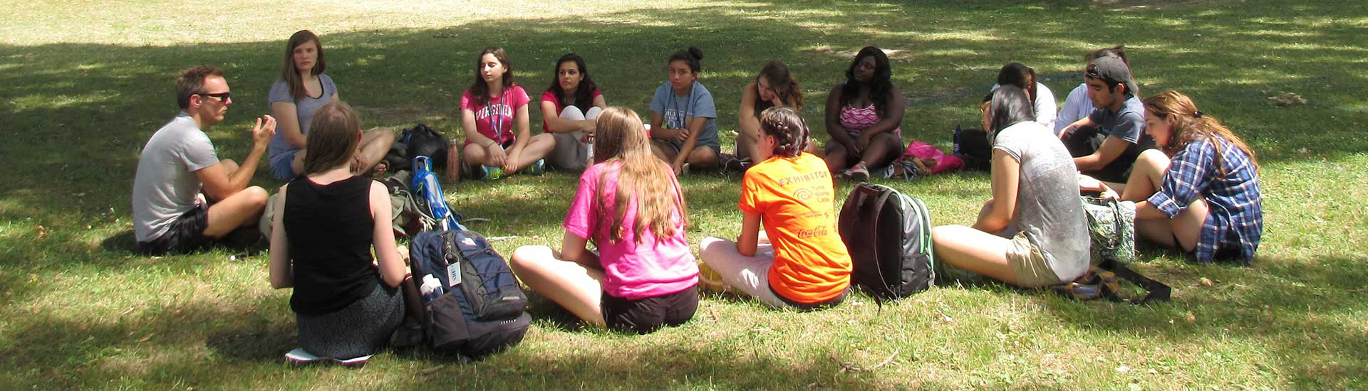 Students sit in a circle for an intensive course