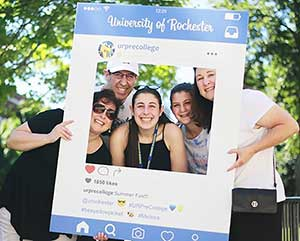 Students pose with cardboard Instagram frame