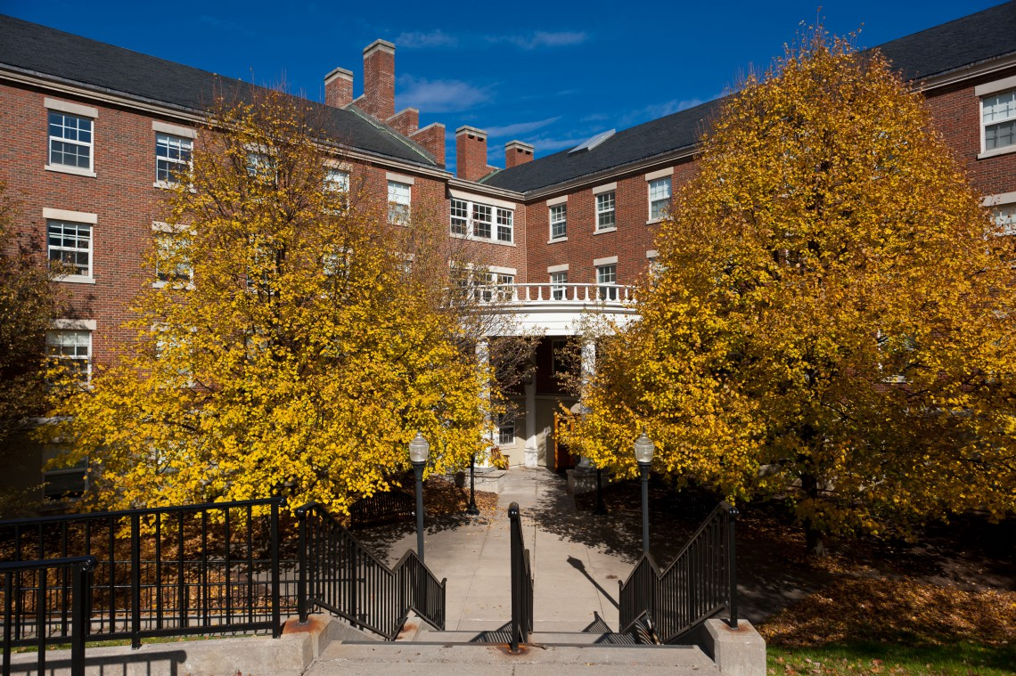 Fall trees flanking student residence hall