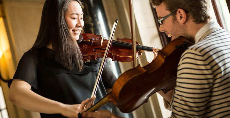 Music students playing the violin