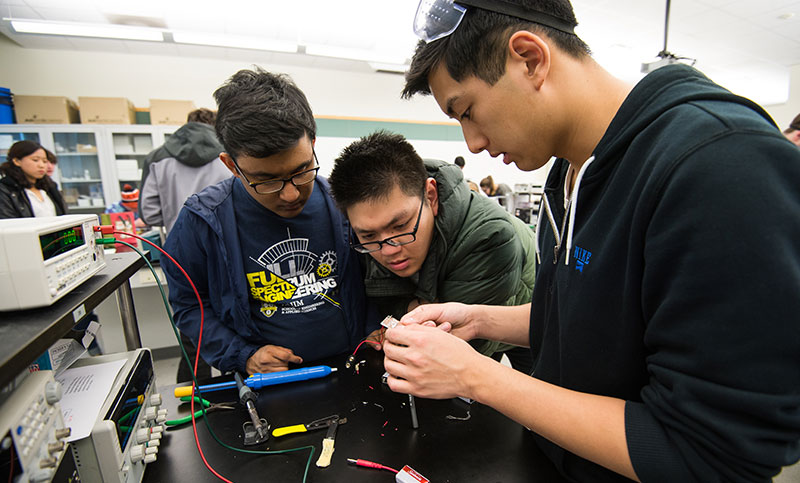 Engineering students working on wiring
